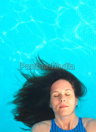 woman with long hair floating in