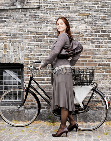 woman with bike in front of