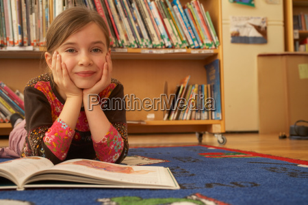 girl reading a book on the
