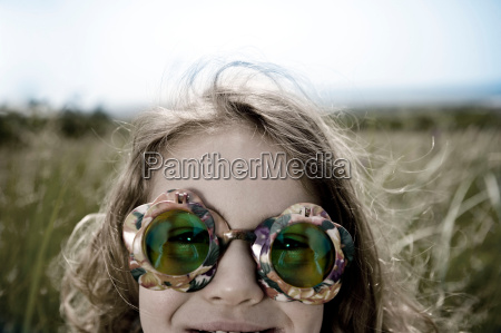 girl wearing green sunglasses