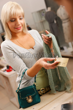 young woman paying with credit card