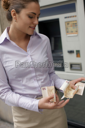 business woman withdrawing cash