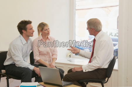 couple in talks with financial advisor