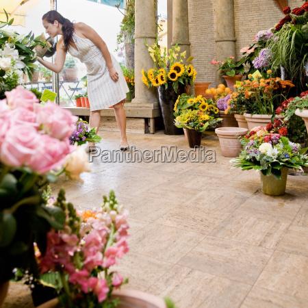 woman standing inside a flower shop