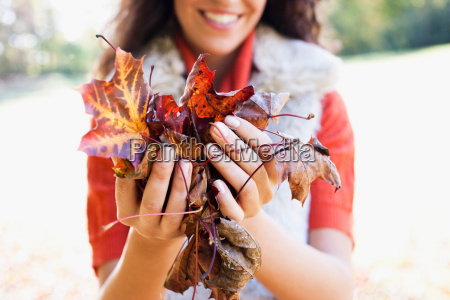 young woman showing leaves