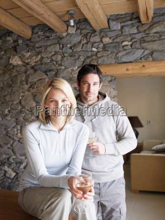 woman and man smiling at viewer