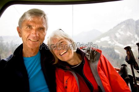senior couple in mountain cable car