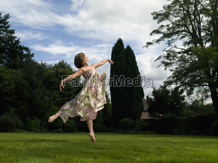 a young woman dancing in a