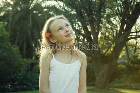 girl standing in garden