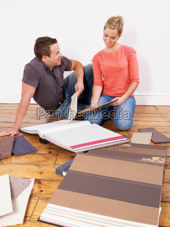 couple looking at carpet samples