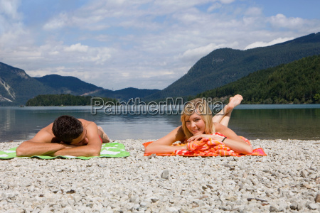 a young couple relaxing by a