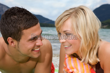 a young couple smiling at each