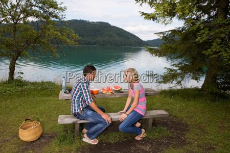 a young couple having a picnic
