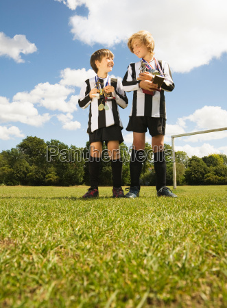 boy footballers with trophies and medals