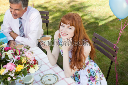 woman and mature man sit at