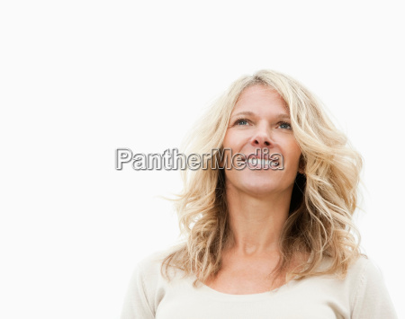 smiling woman looking away from camera