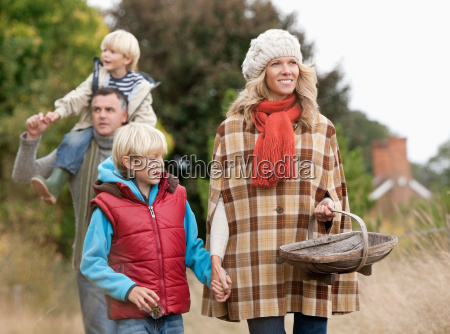 family walking in nature