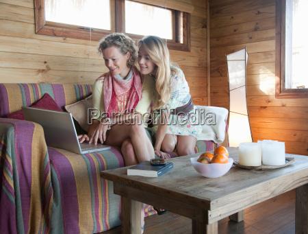 two women in a beach house