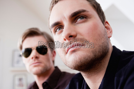 two men looking serious