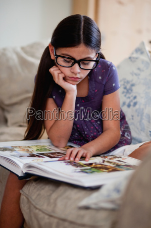 girl looking at picture book