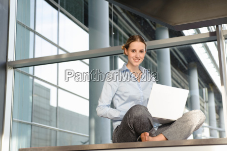 young business woman working with laptop