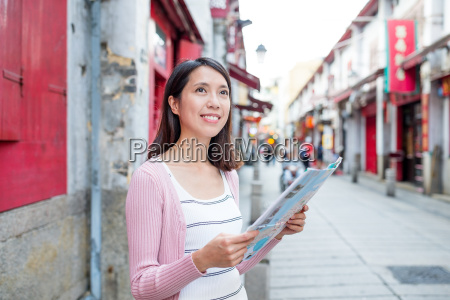 woman using city map in macao