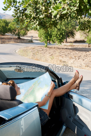 a woman reading a map in