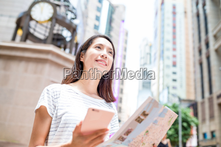 woman using gps and city map