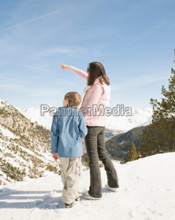 woman and boy looking at snowy