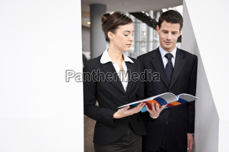 business people looking at brochure