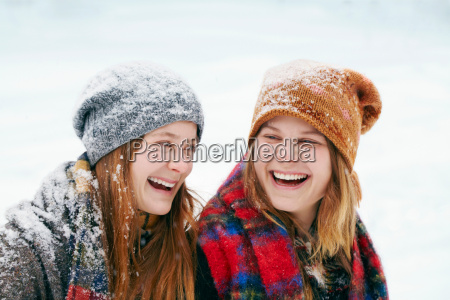 two happy young women in snow