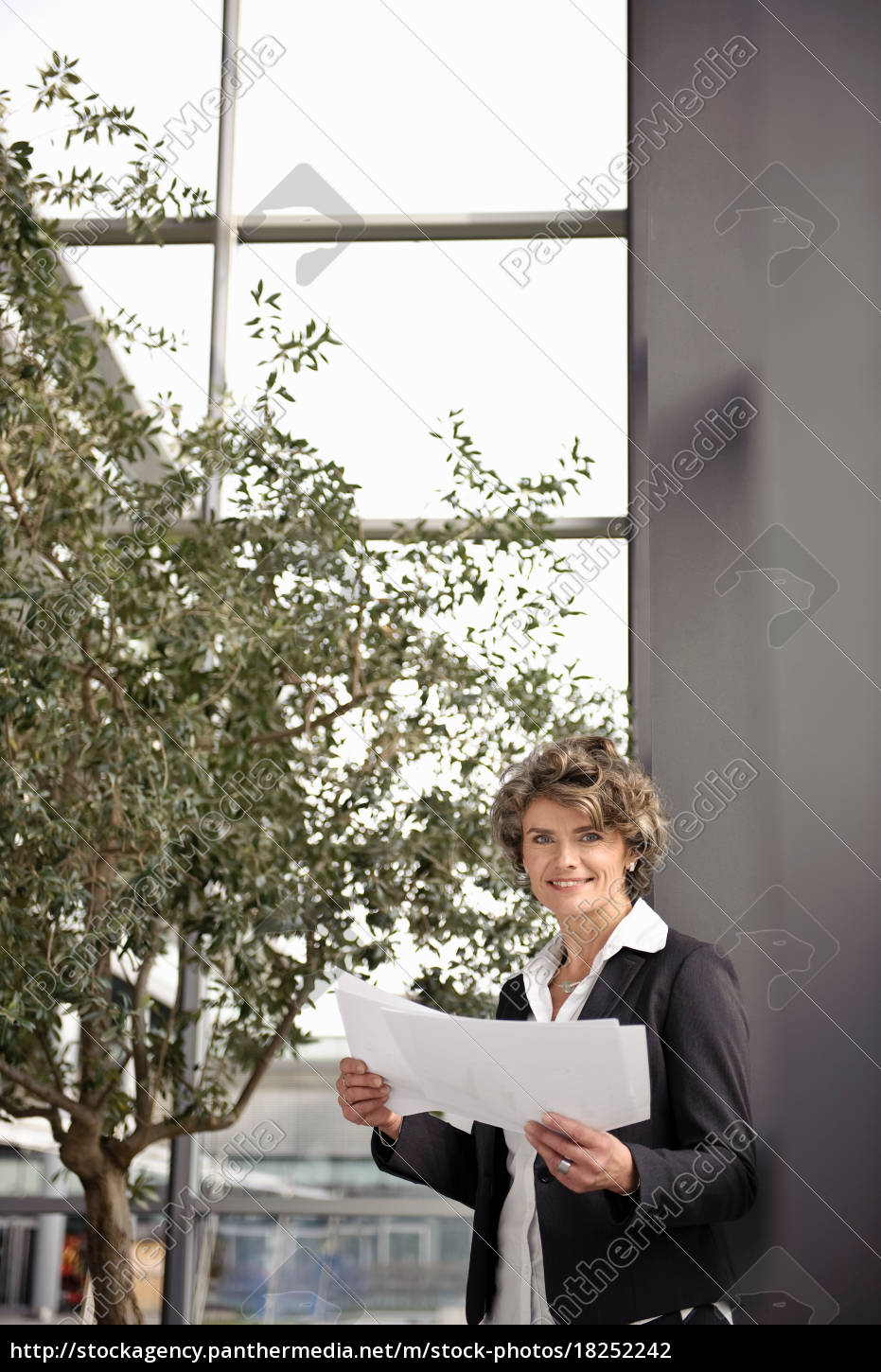 businesswoman, looking, at, paperwork - 18252242