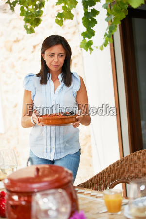 woman bringing food to the lunch