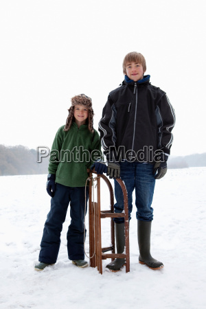 two boys standing next to a