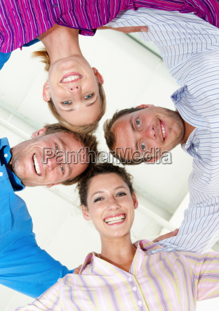 four happy business people