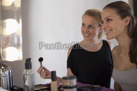 makeup artist model smiling at