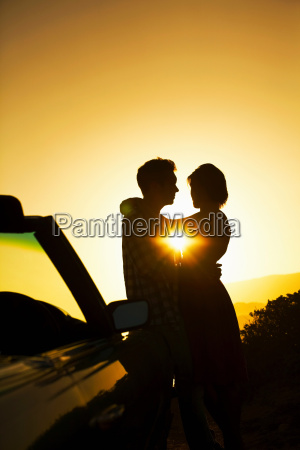 silhouette of couple hugging
