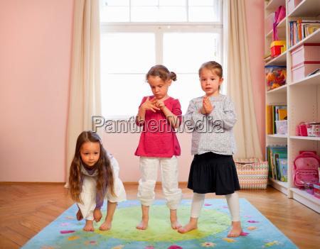 girls playing together on rug
