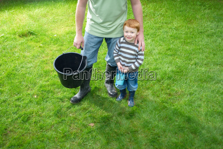 father and son with buckets in