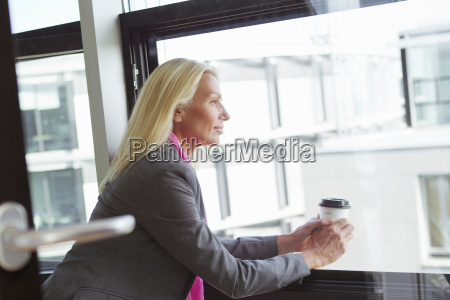 businesswoman having cup of coffee