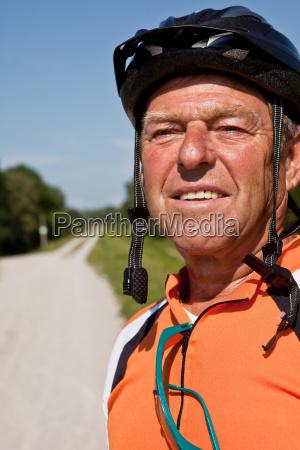older man wearing bike helmet
