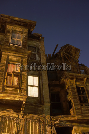lit windows of old wooden buildings