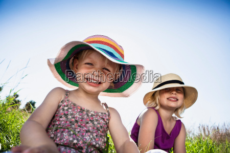 girls sitting together in grass