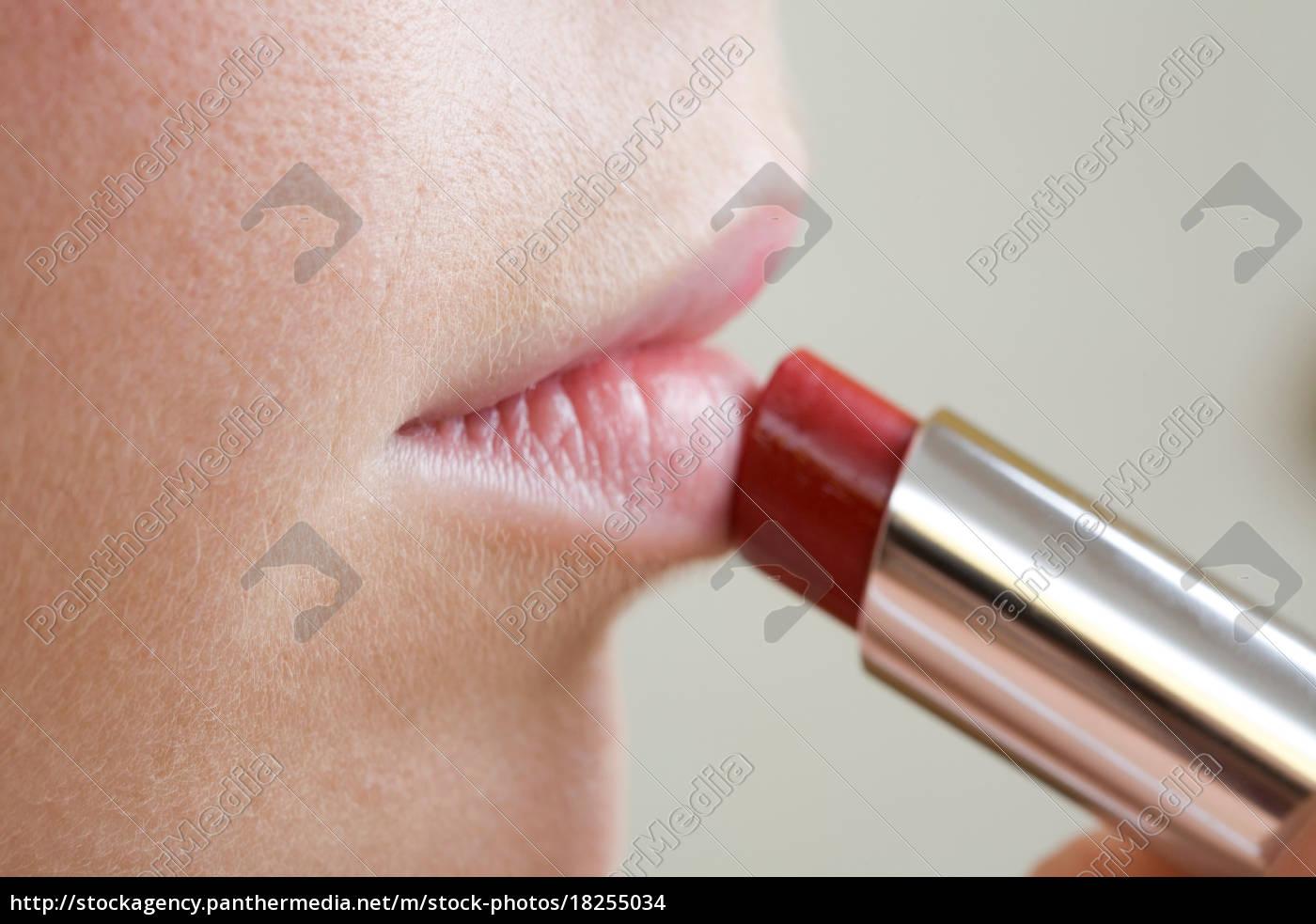 close, up, of, woman, applying, lipstick - 18255034