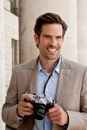 smiling man wearing camera