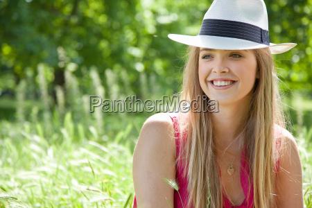 teenage girl wearing hat in tall