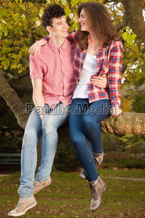 teenage, couple, sitting, in, tree, in - 18256650