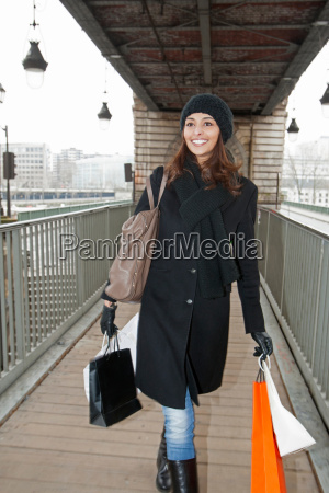 woman carrying shopping bags on platform