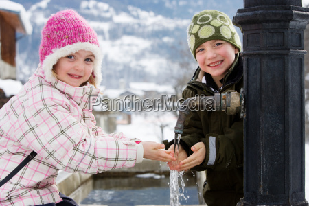 boy and girl holding hands under