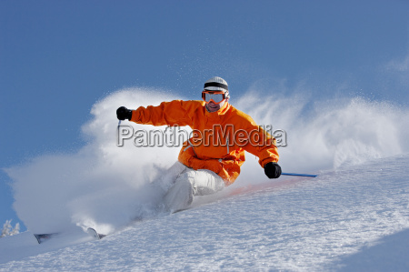 man wearing goggles skiing